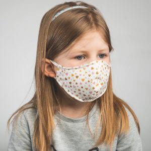 Kinder-Mundmaske MINIMON mit Herzen-Motiv Seitenansicht links