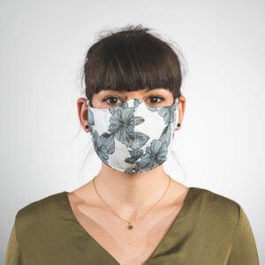 Mundmaske mit weißem Blumenmuster schwarz Vorderansicht